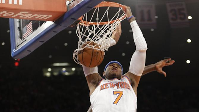 New York Knicks forward Carmelo Anthony (7) dunks in the first half of Game 5 of their first-round NBA basketball playoff series against the Boston Celtics at Madison Square Garden in New York, Wednesday, May 1, 2013. (AP Photo/Kathy Willens)