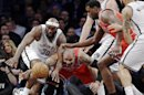 Brooklyn Nets forward Reggie Evans (30) and Chicago Bulls forward Carlos Boozer (5) go for a loose ball in the first half of Game 2 of their first-round NBA basketball playoff series, Monday, April 22, 2013, in New York. (AP Photo/Kathy Willens)