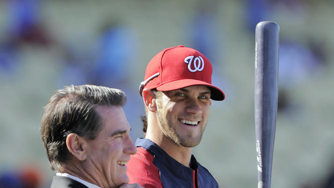 Washington Nationals left fielder Bryce Harper, right, talks with former Los Angeles Dodgers first baseman Steve Garvey prior to the Nationals' baseball game against the Dodgers, Saturday, April 28, 2012, in Los Angeles. (AP Photo/Mark J. Terrill)