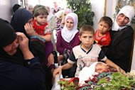 Relatives of Syrian Abu Ismail, who was allegedly killed by a government sniper, mourn over his body during a funeral procession in the city of Qusayr