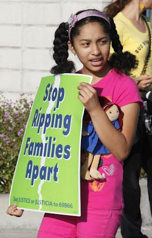 Jaquelin Minero, 12, joins immigrant rights groups in Los Angeles Monday, Aug. 15, 2011, calling for an end to the Department of Homeland Security's (DHS) Secure Communities program, which was created in 2008 and calls for police to submit suspects' fingerprints to DHS so they can be cross-checked with federal deportation orders. (AP Photo/Damian Dovarganes)