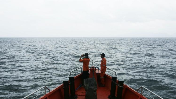 Members of a rescue team take part in a search and rescue operation to find the missing Malaysia Airlines flight MH370, in the Andaman Sea