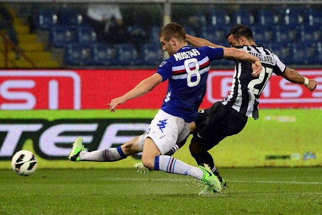Juventus' forward Fabio Quagliarella (R) scores in spite of Sampdoria's defender Shkodran Mustafi on May 18, 2013