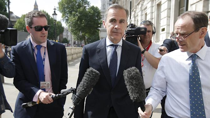 Governor of the Bank of England, Mark Carney, leaves the Cabinet Office following a post-Greek referendum meeting in London