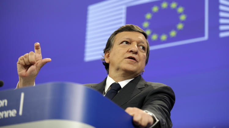 European Commission President Jose Manuel Barroso gestures while speaking during a media conference at EU headquarters in Brussels, Tuesday, May 8, 2012. The European Commission has called on EU nations to stick to their promised budget cuts despite voter discontent in France and Greece, but promised new efforts to boost growth to alleviate economic hardship. (AP Photo/Virginia Mayo)