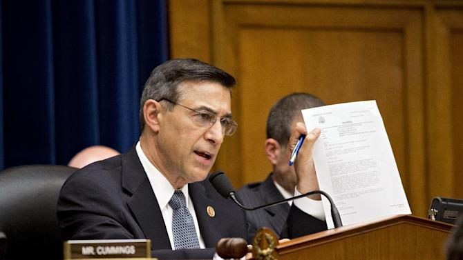 House Oversight Committee Chairman Rep. Darrell Issa, R-Calif., displays a letter of praise from President Obama to Gregory Hicks, former deputy chief of mission in Libya, number two in rank to slain U.S. Ambassador Christopher Stevens, during a House Oversight Committee hearing about last year's deadly assault on the U.S. diplomatic mission in Benghazi, Libya, on Capitol Hill in Washington, Wednesday, May 8, 2013. House Republicans insist the Obama administration is covering up information about the attack, rejecting administration assurances to the contrary and stoking a controversy with implications for the 2016 presidential race.  (AP Photo/J. Scott Applewhite)