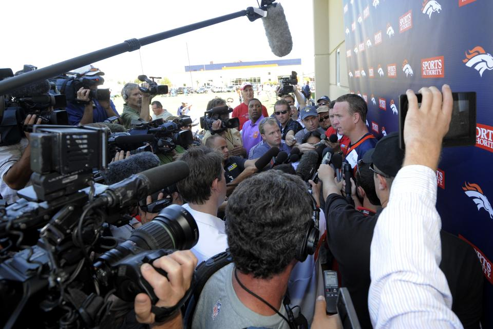 Denver Broncos quarterback Peyton Manning talks to the media following the opening session of Denver Broncos NFL football training camp in Englewood, Colo., Thursday, July 26, 2012. (AP Photo/Jack Dempsey)