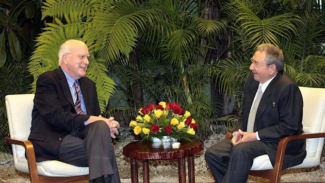 In this picture released by Cuba's state newspaper Granma, Cuba's President Raul Castro, right, talks with U.S. Sen. Patrick Leahy at Revolution Palace in Havana, Cuba, Tuesday, Feb. 19, 2012. U.S. lawmakers confirmed on Wednesday that they visited an American man whose detention and long sentence in Cuba has hampered efforts to improve ties between the countries, but they gave no details on his condition or what was said. (AP Photo/Granma, Estudios Revolucion )