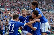 Schalke's midfielder Lewis Holtby (2nd L) and his teamates celebrate scoring during the German first division Bundesliga football match Hanover 96 vs Schalke 04 in Hanover, northern Germany. Champions League side Schalke 04 were held to a 2-2 draw at Hanover 96