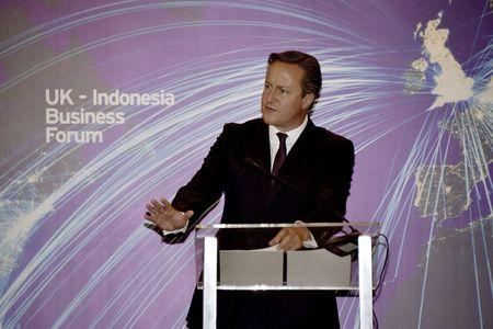 Britain's Prime Minister Cameron delivers his speech during the UK-Indonesia Business Forum in Jakarta