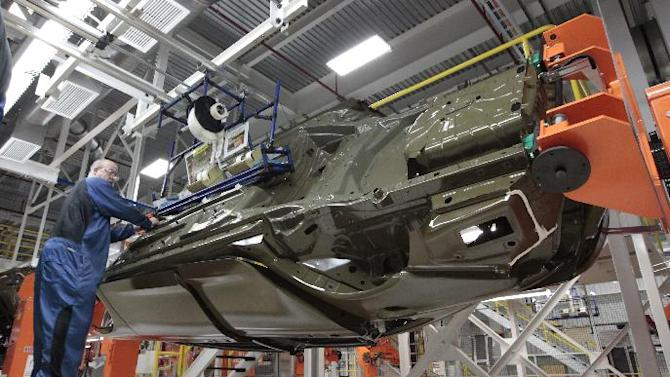 In this March 14, 2014 photo, an assembly line worker works on a 2015 Chrysler 200 automobile at the Sterling Heights Assembly Plant in Sterling Heights, Mich. The Commerce Department releases durable goods for June on Friday, July 25, 2014. (AP Photo/Paul Sancya)