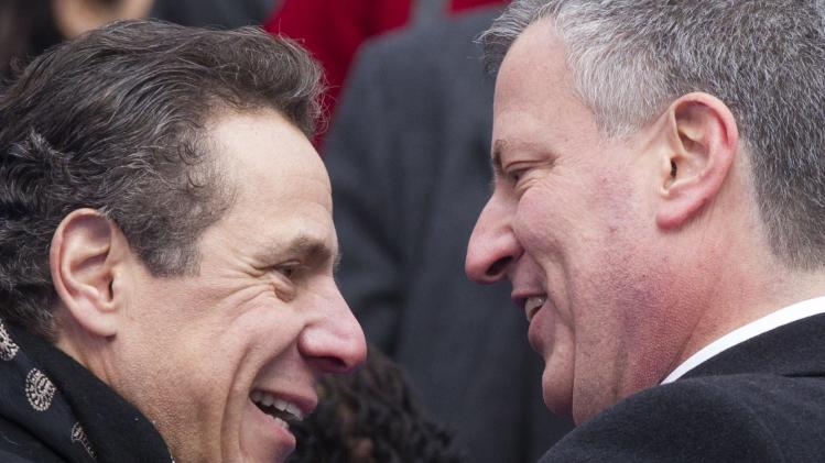 New York City Mayor Bill de Blasio greets New York Governor Andrew Cuomo after his inauguration ceremony in New York
