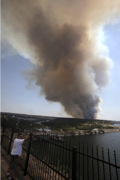 Smoke rises from a wildfire at Possum Kingdom Lake, Texas, Wednesday, Aug. 31, 2011. The wildfire that swept through the Possum Kingdom Lake neighborhood, one of several burning in Texas and Oklahoma,