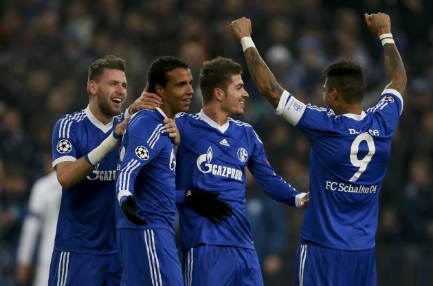 Schalke 04's Szalai, Matip, Neustaedter and Boateng celebrate Matip's goal during their Champions League group E soccer match against FC Basel in Gelsenkirchen