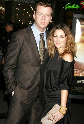 Joseph McGinty Nichol , director and Drew Barrymore at the Hollywood premiere of Warner Bros. Pictures' We Are Marshall