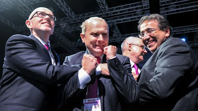 Delegates from Swiss city of Lausanne bid committee react after the announcement of the 2020 Youth Winter Olympics winning bid city, during the 128th IOC Session in Kuala Lumpur