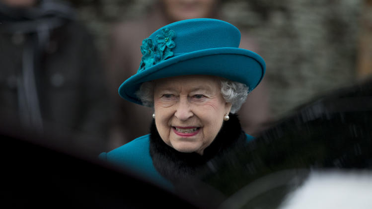 Britain's Queen Elizabeth II walks to get in her car after attending the British royal family's traditional Christmas Day church service in Sandringham, England, Tuesday, Dec. 25, 2012.  (AP Photo/Matt Dunham)