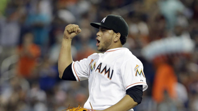 Miami Marlins' Henderson Alvarez celebrates after striking out Detroit Tigers' Matt Tuiasosopo for the last out of the ninth inning of an interleague  baseball game, Sunday, Sept. 29, 2013, in Miami.  Alvarez got a no-hitter as the Marlins won 1-0