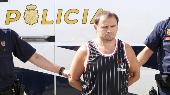 FILE - In this Thursday, Aug. 26, 2010 file handout photo from Spain's Interior Ministry,  war crimes suspect, Veselin Vlahovic, before he was extradited from Spain. A court in Bosnia on Friday, March 29, 2013, convicted a Montenegrin man of multiple counts of murder, torture, rape and looting during Bosnia's 1992-95 war, and sentenced him to 45 years in prison _ the highest sentence ever issued in the country.  Judge Zoran Bozic said that Veselin Vlahovic, killed 31 people, raped a number of Bosniak and Croat women and tortured and robbed non-Serb residents of a Sarajevo suburb while fighting for the Bosnian Serbs. Among other crimes, the judge described how Vlahovic cut the throats of two brothers in front of their mother, then killed her and raped the men's wives.  (AP Photo/Spain's Interior Ministry, File)