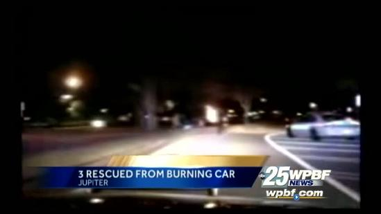 Dash cam video shows rescue from burning car