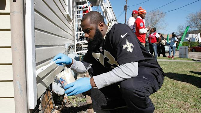 IMAGE DISTRIBUTED FOR REBUILDING TOGETHER - Kickoff to Rebuild, the Super Bowl Charity event with Rebuilding Together, Lowe's and New Orleans Saints player Junior Galette works on a house on the corner of Corner of DeArmas Street & Odeon Avenue in New Orleans, Louisiana on Friday, Feb. 1, 2013. (Scott Boehm / AP Images for Rebuilding Together)