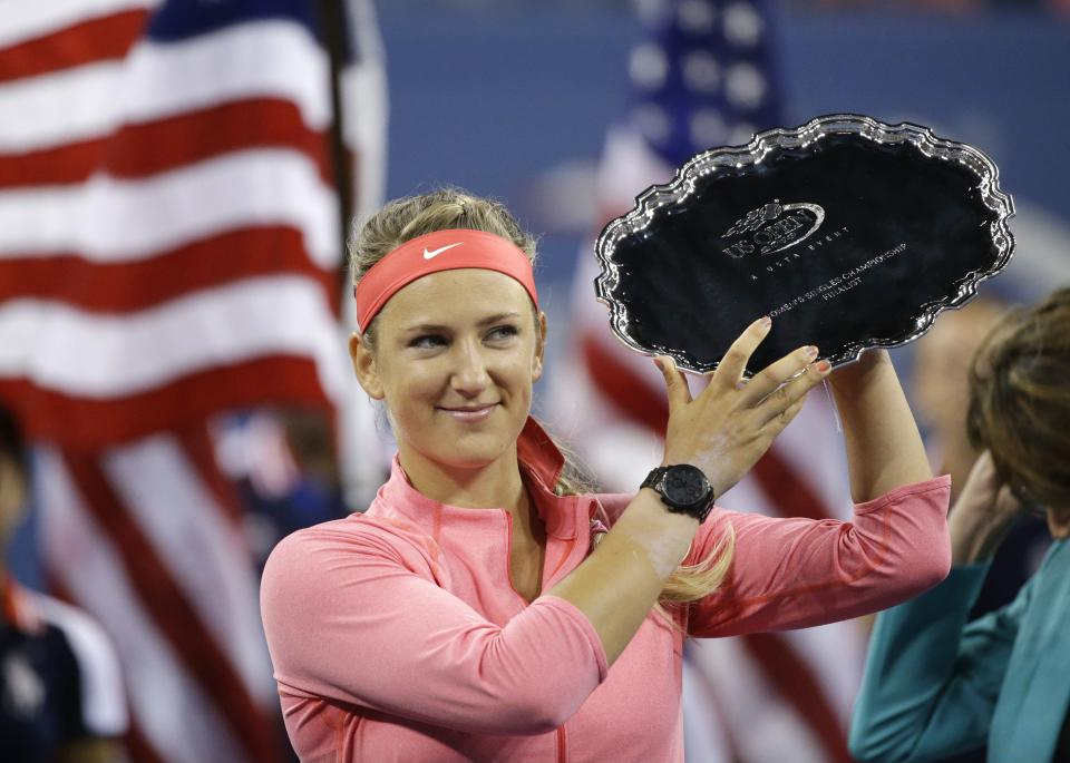 Victoria Azarenka, of Belarus, holds up the second place trophy after losing to Serena Williams during the women's singles final of the 2013 U.S. Open tennis tournament, Sunday, Sept. 8, 2013, in New York. (AP Photo/David Goldman)