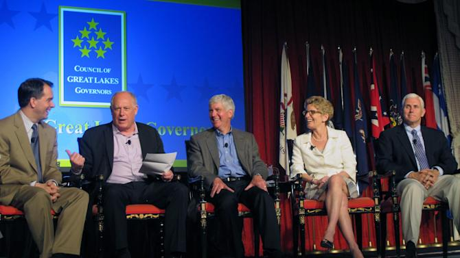 In this photo taken June 1, 2013, on Mackinac Island, Mich., members of the Council of Great Lakes Governors discuss regional policies on trade and water quality. From left: Wisconsin Gov. Scott Walker, Illinois Gov. Pat Quinn, Michigan Gov. Rick Snyder, Ontario Premier Kathleen Wynne, and Indiana Gov. Mike Pence. (AP Photo/John Flesher)
