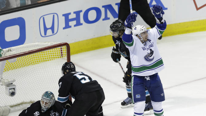 Vancouver Canucks center Alex Burrows (14)celebrates after scoring past San Jose Sharks goalie Antti Niemi, of Finland, during the third period of Game 4 of their first-round NHL hockey Stanley Cup playoff series in San Jose, Calif., Tuesday, May 7, 2013. (AP Photo/Marcio Jose Sanchez)