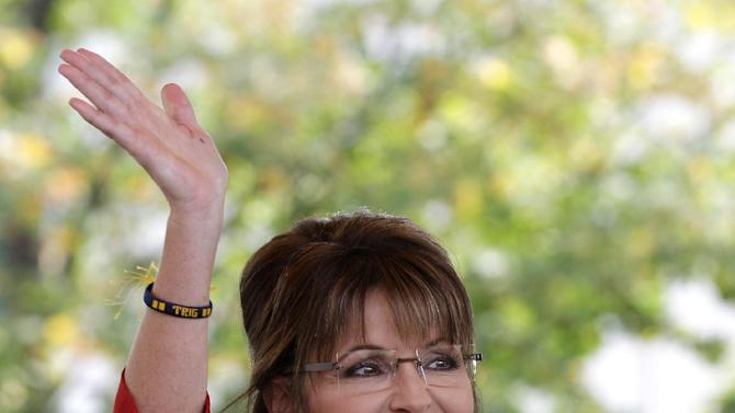 """FILE - In this Sept. 5, 2011 file photo, former Republican vice presidential candidate and Alaska Gov. Sarah Palin waves to supporters before addressing a Tea Partly Express Rally in Manchester, N.H. Palin's husband Todd, released a statement on Thursday, Sept. 15, 2011, responding to Joe McGinniss' """"The Rogue: Searching for the Real Sarah Palin,""""  as """"disgusting lies, innuendo and smears"""" as the former Alaska governor's camp sought to discredit a racy biography that includes allegations of infidelity and drug use. (AP Photo/Stephan Savoia, file)"""