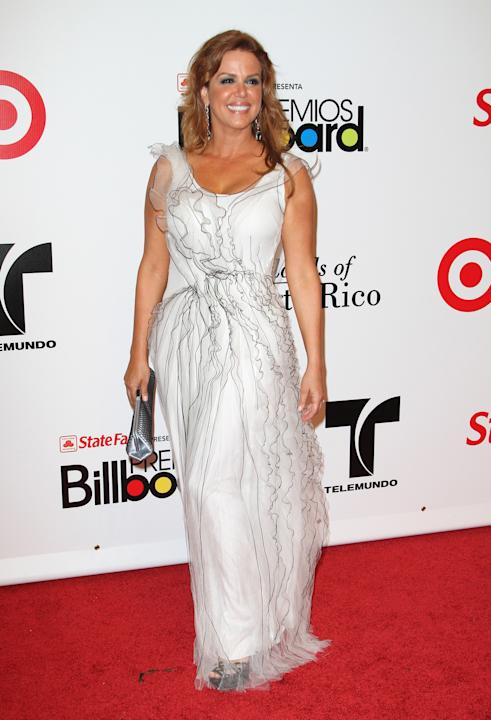 "Maria Celeste Arraras, host and producer of Telemundo's ""Al Rojo Vivo Con Maria,"" in a white gown"