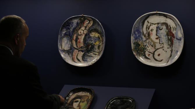 """In this photo taken Wednesday, Feb. 13, 2013, displayed are ceramics made by artist Marc Chagall on display for """"Chagall: Beyond Color,"""" exhibit at the Dallas Museum of Art in Dallas. This will be the only U.S. venue to host the exhibit that opens to the public on Sunday. (AP Photo/LM Otero)"""