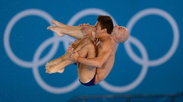 Tom Daley and Peter Waterfield in action (PA)