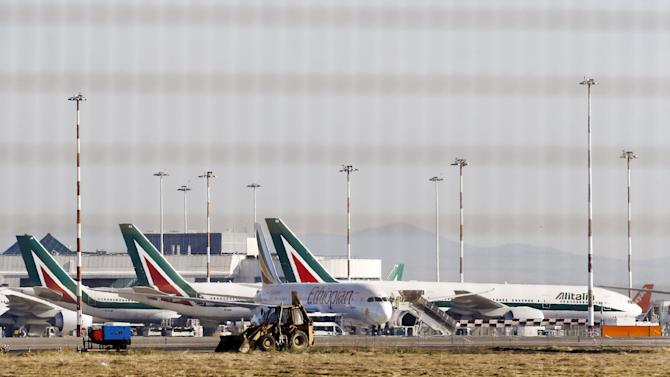 Airplanes are parked on the tarmac at the international Fiumicino airport in Rome