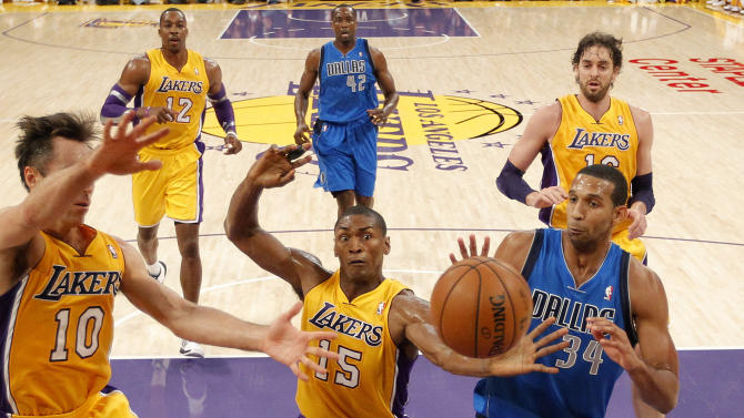 Dallas Mavericks' Brandan Wright, right, Los Angeles Lakers' Metta World Peace, center, and Los Angeles Lakers' Steve Nash go after a rebound in the first half of an NBA basketball game in Los Angeles, Tuesday, Oct. 30, 2012. (AP Photo/Jae C. Hong)