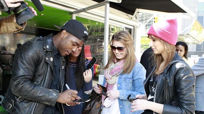 """IMAGE DISTRIBUTED FOR HTC - Luke James, a 2013 GRAMMY Awards nominated artist, delighted New Yorkers in Columbus Circle at the HTC BoomSound Lounge by signing autographs, interacting with fans, and having photos taken with the new HTC One, a breakthrough smartphone that reinvents the mobile experience on Friday, April 5, 2013 in New York. James is a NARS Records/Island Def Jam recording artist and his new single """"I.O.U."""" is available now.  The new HTC One is available for pre-order today through AT&T, Sprint and Best Buy. (Mark Von Holden / AP Images for HTC)"""