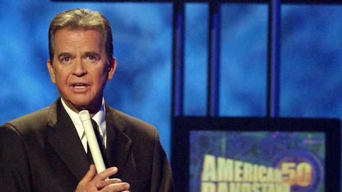 """FILE - In this April 20, 2002 file photo, Dick Clark, host of the American Bandstand television show, introduces entertainer Michael Jackson on stage during taping of the show's 50th anniversary special in Pasadena, Calif. Clark, the television host who helped bring rock `n' roll into the mainstream on """"American Bandstand,"""" died  April 18, 2012 of a heart attack. He was 82. (AP Photo/Kevork Djansezian, File)"""