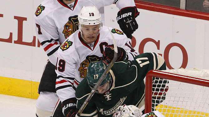 Chicago Blackhawks' goalie Corey Crawford (50) blocks a shot by Minnesota Wild's Torrey Mitchell in the first period of Game 3 of a first-round NHL hockey Stanley Cup playoff series on Sunday, May 5, 2013, in St. Paul, Minn. (AP Photo/Andy King)