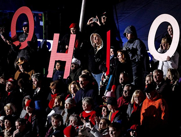 Supporters spell out &quot;Ohio&quot; as they cheer for Republican presidential candidate, former Massachusetts Gov. Mitt Romney, not pictured, as he speaks during a campaign event at The Square at Union Centre, Friday, Nov. 2, 2012, in West Chester, Ohio. (AP Photo/David Goldman)