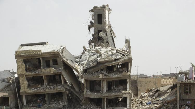 A general view shows damaged houses in the city of Ramadi