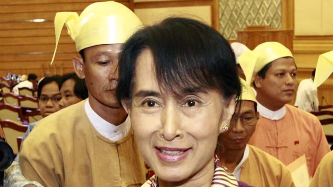 Opposition leader Aung San Suu Kyi speaks to reporters after attending a regular session of Myanmar Lower House, in Naypyitaw, Myanmar, Wednesday, May 2, 2012. Suu Kyi was set to be sworn in to Myanmar's military-backed parliament Wednesday to take public office for the first time since launching her struggle against authoritarian rule nearly a quarter century ago. (AP Photo/Khin Maung Win)