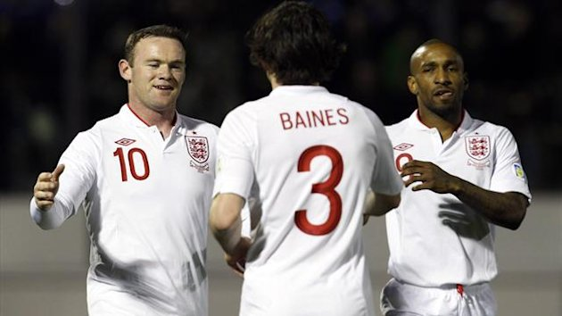 (L-R) Wayne Rooney, Leighton Baines and Jermain Defoe of England celebrate after San Marino scored an own goal during their 2014 World Cup qualifying soccer match at the Serravalle Stadium in San Marino, March 22, 2013. REUTERS