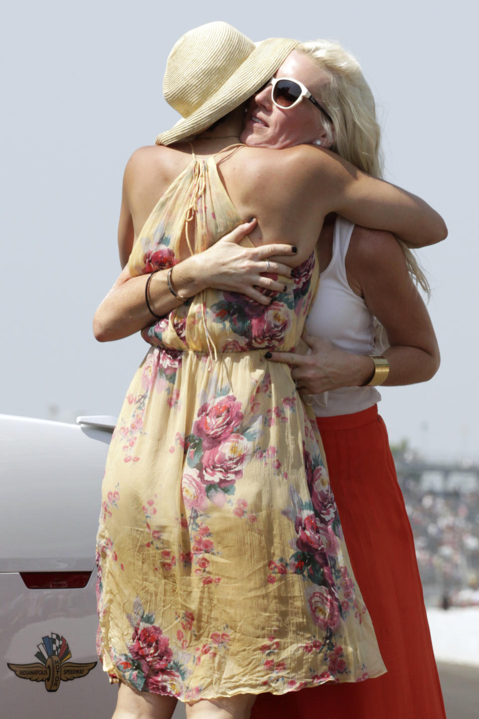 Actress Ashley Judd, left, hugs Susie Wheldon after Judd's husband, Dario Franchitti, of Scotland, won IndyCar's Indianapolis 500 auto race at Indianapolis Motor Speedway in Indianapolis, Sunday, May 27, 2012. (AP Photo/AJ Mast)