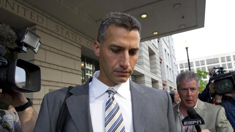 Andy Pettitte leaves the Federal Court in Washington, Tuesday, May 1, 2012. Pettitte took the stand Tuesday in the retrial of charges that Roger Clemens lied when he told Congress in 2008 that he had never used steroids or human growth hormone. (AP Photo/Manuel Balce Ceneta)