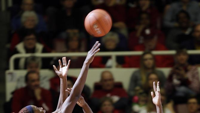 California 's Gennifer Brandon (25) shoots over Stanford 's Chiney Ogwumike (13) and Joslyn Tinkle (44) during the first half of an NCAA college basketball game in Stanford, Calif., Sunday, Jan. 13, 2013. (AP Photo/Marcio Jose Sanchez)