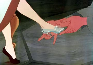 Cinderella tries on the glass slipper in Walt Disney Pictures' Cinderella