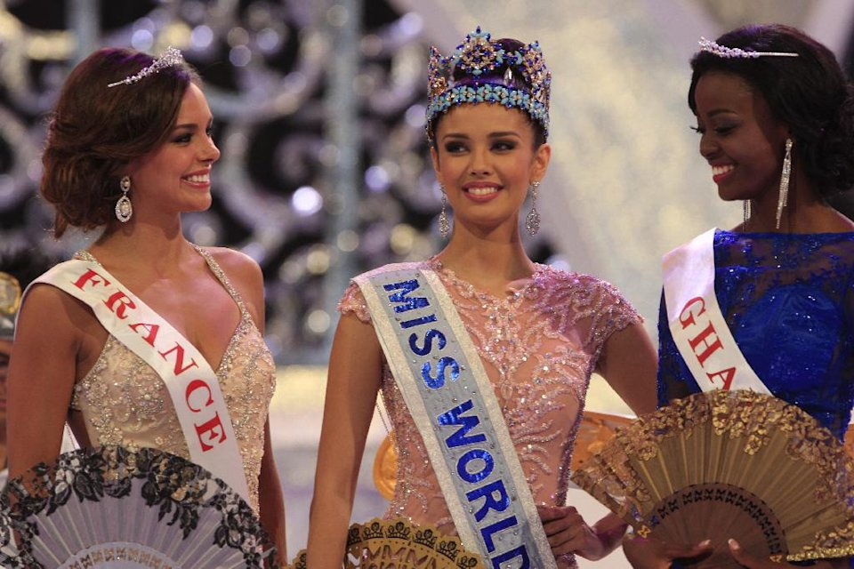 Newly crowned Miss World, Megan Young of Philippines, center, with second runner-up Miss France Marine Lorpheline, left, and third runner-up Miss Ghana Carranza Naa Okailey Shooter, smile after they winning the Miss World contest in Nusa Dua, Bali, Indonesia, Saturday, Sept. 28, 2013. (AP Photo/Firdia Lisnawati)