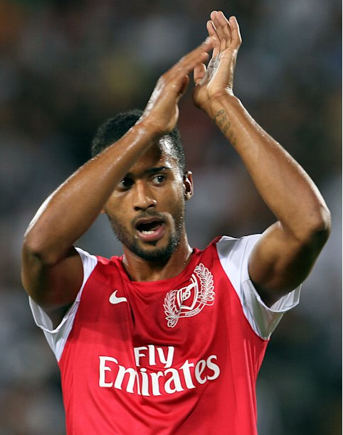 Arsenal's Armand Traorè celebrates at the end of Arsenal vs Udinese Champions League qualifying playoff second leg soccer match in Udine, Italy, Wednesday, Aug. 24, 2011. Arsenal won 2-1 and advances 3-1 on aggregate. (AP Photo/Paolo Giovannini)