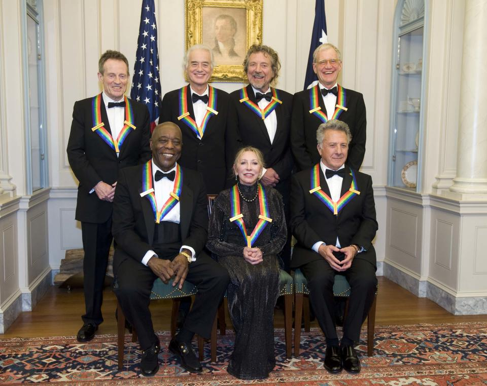 The 2012 Kennedy Center Honorees, from left, John Paul Jones, Buddy Guy, Jimmy Page, Natalia Makarova, Robert Plant, Dustin Hoffman, and David Letterman pose for a group photo after the State Department Dinner for the Kennedy Center Honors gala Saturday, Dec. 1, 2012 at the State Department in Washington. (AP Photo/Kevin Wolf)