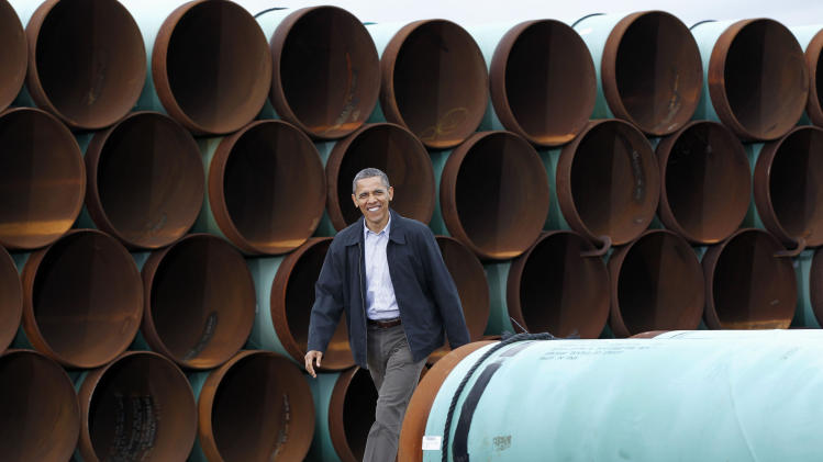 FILE - In this March 22, 2012 file photo, President Barack Obama arrives at the TransCanada Stillwater Pipe Yard in Cushing, Okla. His re-election safely behind him, President Obama is facing mounting pressure to settle a decision that has been trailing him for years: whether to approve the $7 billion proposed Keystone XL pipeline between the U.S. and Canada.  (AP Photo/Pablo Martinez Monsivais, File)