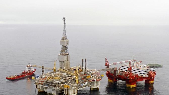 """This is an undated image released by Statoil of the Statoil  hotel rig Flotel Superior, right,  and the Njord A-platform in the  Norwgian Sea. Statoil on Wednesday Nov. 7, 2012 evacuated 326 oil rig workers from a North Sea platform after the structure began to tilt, the Norwegian oil company said. Company spokesman Ole Anders Skauby said that most of the 374 people on the """"Floatel Superior"""" were airlifted by helicopter after one of the floating pontoons started taking on water, causing the structure to list. (AP Photo/Statoil) NORWAY OUT"""